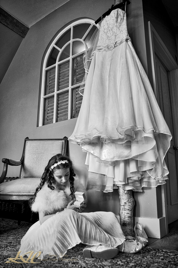 Bridesmaid with wedding rings and wedding dress in black & white